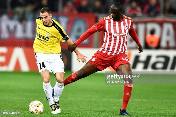 Olympiakos' Ivorian midfielder Yaya Toure vies for the ball with F91 Dudelange's German midfielder Edisson Jordanov during the UEFA Europa League...