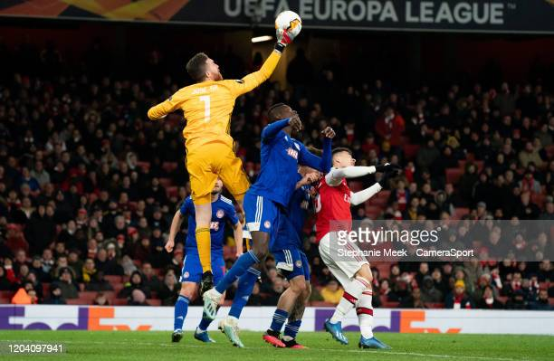 Olympiakos' Jose Sa makes a save during the UEFA Europa League round of 32 second leg match between Arsenal FC and Olympiacos FC at Emirates Stadium...