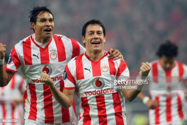 Olympiakos' Luciano Galleti and Dudu celebrate after Galleti scored a goal against Herta during their group B UEFA Cup soccer match against...