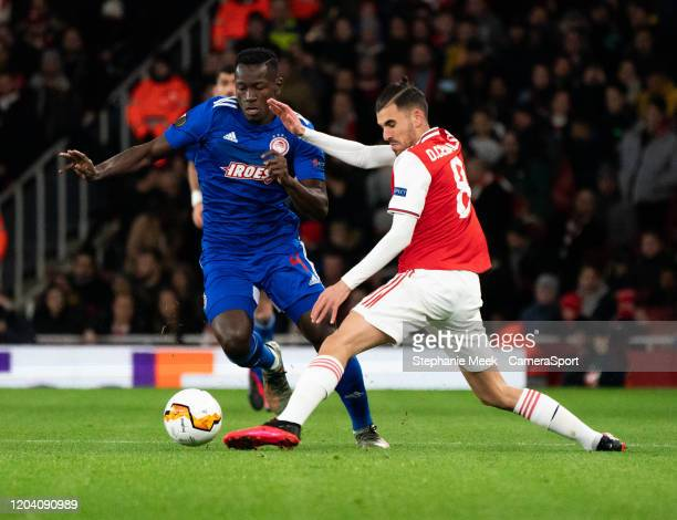 Olympiakos' Mady Camara is tackled by Arsenal's Dani Ceballos during the UEFA Europa League round of 32 second leg match between Arsenal FC and...