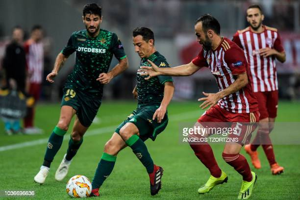 Olympiakos' midfielder Bibras Natcho fights for the ball with Real Betis' midfielder Andres Guardado during the UEFA Europa League Group F football...