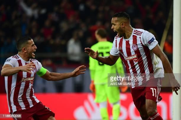 Olympiakos' Moroccan forward Youssef ElArabi celebrates scoring a penalty with Olympiakos' Norwegian defender Omar Elabdellaoui during UEFA Champions...