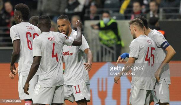 Olympiakos' Moroccan forward Youssef El-Arabi celebrates scoring the 1-1 from the penatly spot with his teammates during the UEFA Europa League group...