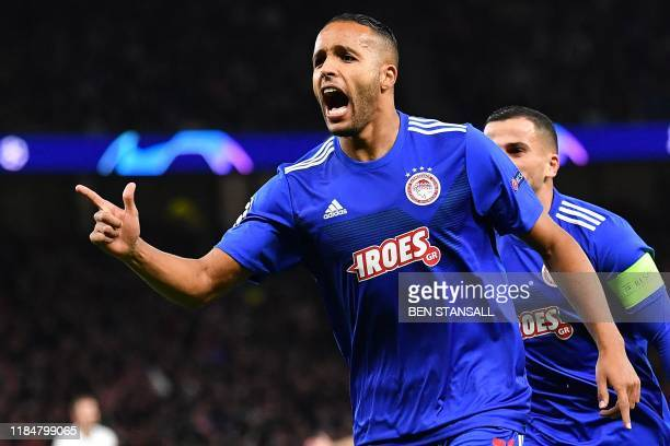 Olympiakos' Moroccan forward Youssef ElArabi celebrates scoring the opening goal during the UEFA Champions League Group B football match between...