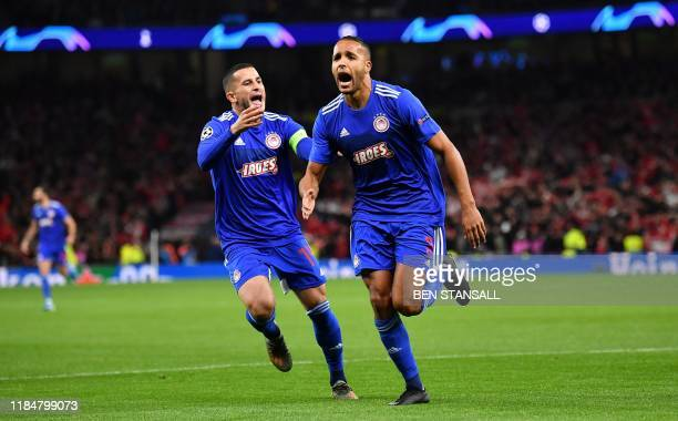 Olympiakos' Moroccan forward Youssef El-Arabi celebrates scoring the opening goal during the UEFA Champions League Group B football match between...