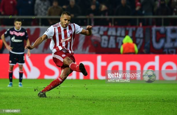 Olympiakos' Moroccan forward Youssef El-Arabi scores a penalty during UEFA Champions League during the Group B football match between Olympiacos FC...