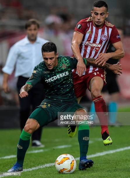Olympiakos' Omar Elabdellaoui fights for the ball with Real Betis' Cristian Tello during the UEFA Europa League Group F football match between...