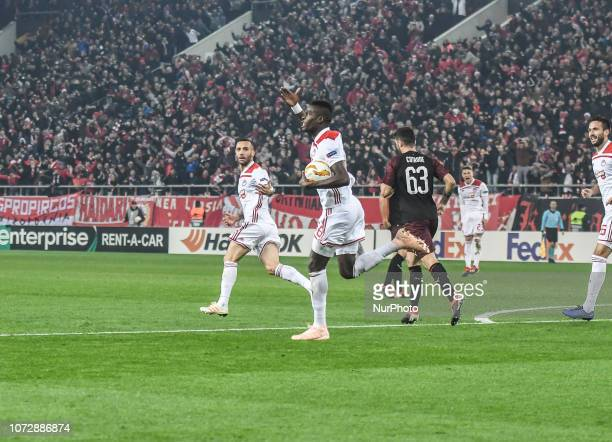 Olympiakos' Pape Abou Cisse celebrates after scoring a goal during their UEFA league match Olympiacos FC and AC Milan at the Karaiskaki stadium in...
