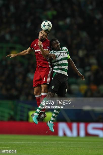 Olympiakos Piraeus defender Alberto Botia from Spain vies with Sporting CP midfielder William Carvalho from Portugal for the ball possession during...