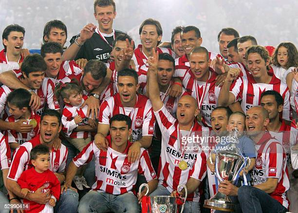 Olympiakos Piraeus football team celebrates their championship and the Cup win during the official award ceremony in the Karaiskaki stadium in...