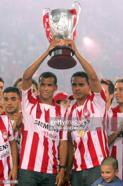 Olympiakos Piraeus football team's Brazilian stars Rivaldo and Giovanni raise the Cup during the official award ceremony in the Karaiskaki stadium in...