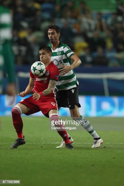 Olympiakos Piraeus forward Uros Djurdjevic from Serbia vies with Sporting CP defender Andre Pinto from Portugal for the ball possession during the...