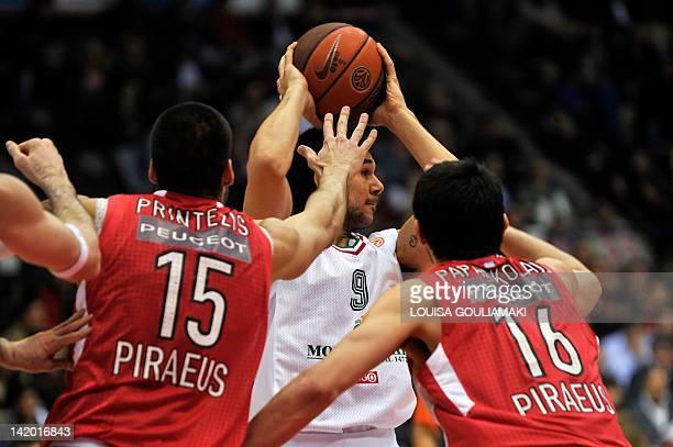 Olympiakos Piraeus Georgios Printezis and Kostas Papanikolaou block Montepaschi Siena's Marco Carrareto during their Euroleague playoffs game 3 at...