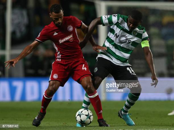 Olympiakos Piraeus midfielder Alaixys Romao from Tongo with Sporting CP midfielder William Carvalho from Portugal in action during the UEFA Champions...