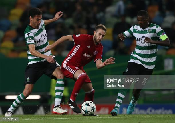 Olympiakos Piraeus midfielder Kostas Fortounis from Greece with Sporting CP defender Andre Pinto from Portugal and Sporting CP midfielder William...
