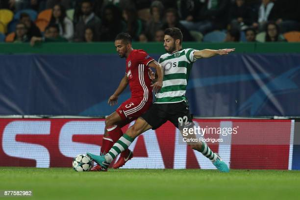 Olympiakos Piraeus midfielder Mehdi Carcela Gonzalez from Marrocos vies with Sporting CP defender Cristiano Piccini from Italy for the ball...