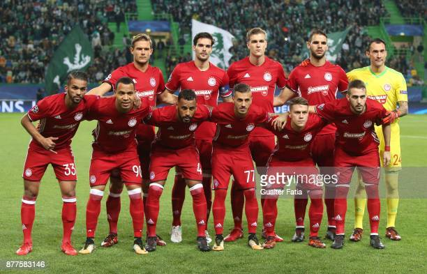 Olympiakos Piraeus players pose for a team photo before the start of during the UEFA Champions League match between Sporting Clube de Portugal and...