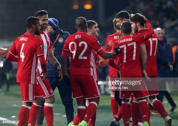 Olympiakos' players celebrate after forward Karim Ansarifard scored a goal during the UEFA Europa League round of 32 second leg soccer match...