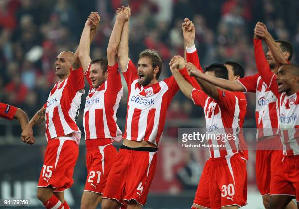 Olympiakos players celebrate victory at the final whistle during the UEFA Champions League Group H match between Olympiakos and Arsenal at the...