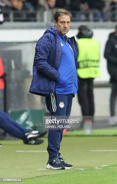Olympiakos' Portuguese coach Pedro Martins reacts from the sidelines during the UEFA Europa League group D football match between Eintracht Frankfurt...