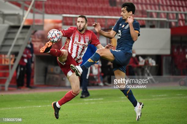 Olympiakos' Portuguese defender Ruben Semedo controls the ball in front of FC Porto's Portuguese defender Diogo Leite during the UEFA Champions...