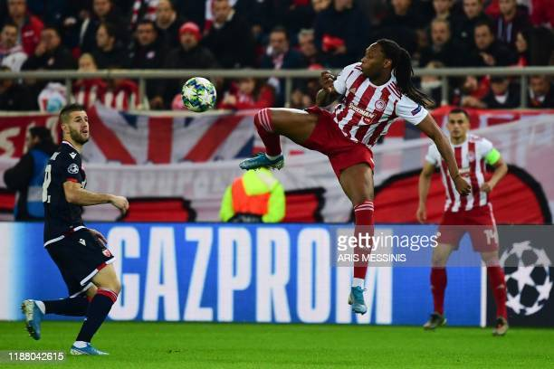Olympiakos' Portuguese defender Ruben Semedo jumps for the ball during UEFA Champions League during the Group B football match between Olympiacos FC...