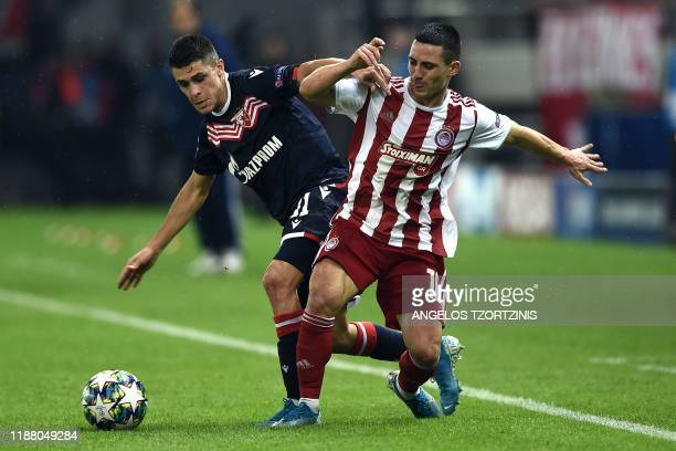 Olympiakos' Portuguese forward Daniel Podence vies with Red Star's Argentine forward Mateo Garcia during the UEFA Champions League Group B football...
