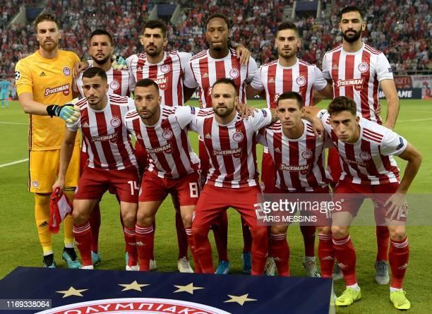 Olympiakos' Portuguese goalkeeper Jose Sa Olympiakos' Greek midfielder Andreas Bouchalakis Olympiakos' Portuguese defender Ruben Semedo Olympiakos'...