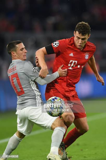 Olympiakos' Portuguese midfielder Daniel Podence and Bayern Munich's French defender Benjamin Pavard vie for the ball during the UEFA Champions...