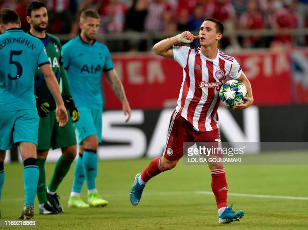 Olympiakos' Portuguese midfielder Daniel Podence celebrates after scoring a goal during the UEFA Champions League Group B football match Olympiakos...