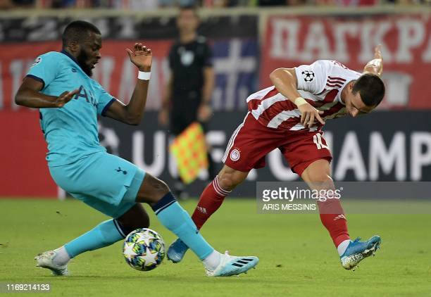 Olympiakos' Portuguese midfielder Daniel Podence challenges Tottenham Hotspur's French midfielder Tanguy Ndombele during the UEFA Champions League...