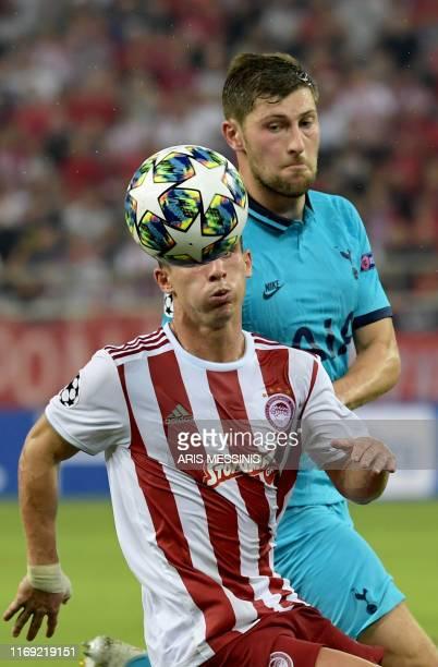 Olympiakos' Portuguese midfielder Daniel Podence eyes the ball during the UEFA Champions League Group B football match Olympiakos vs Tottenham...