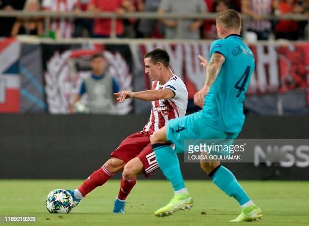 Olympiakos' Portuguese midfielder Daniel Podence fights for the ball against Tottenham Hotspur's Belgian defender Toby Alderweireld during the UEFA...