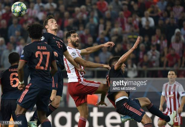 Olympiakos' Portuguese midfielder Daniel Podence heads the ball during the UEFA Champions League group B football match between Olympiacos FC and FC...
