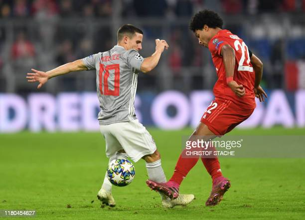 Olympiakos' Portuguese midfielder Daniel Podence L0 and Bayern Munich's German midfielder Serge Gnabry vie for the ball during the UEFA Champions...
