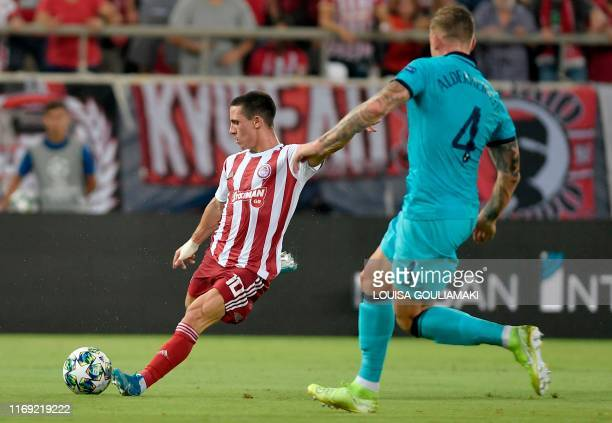 Olympiakos' Portuguese midfielder Daniel Podence readies to kick the ball away from Tottenham Hotspur's Belgian defender Toby Alderweireld during the...