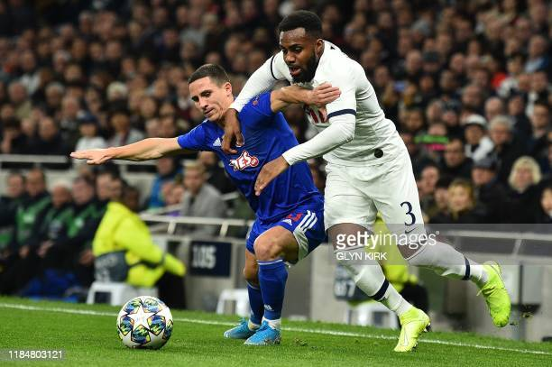 Olympiakos' Portuguese midfielder Daniel Podence vies with Tottenham Hotspur's English defender Danny Rose during the UEFA Champions League Group B...