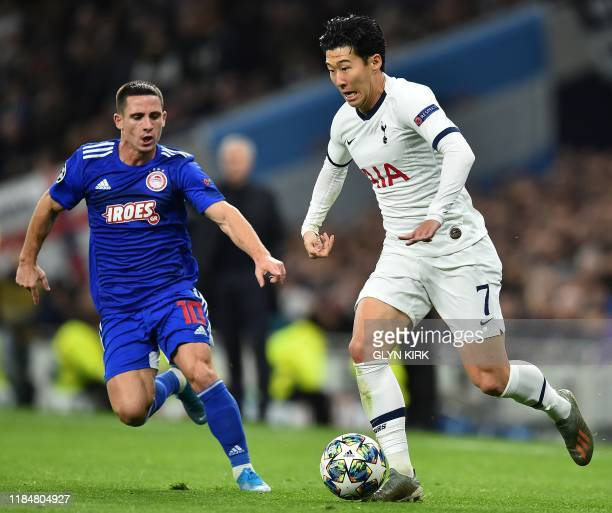 Olympiakos' Portuguese midfielder Daniel Podence vies with Tottenham Hotspur's South Korean striker Son HeungMin during the UEFA Champions League...