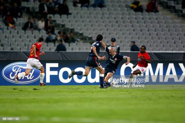 Olympiakos' Predrag Djordjevic tries to find some space amongst his teammate Stylianos Venetidis and Galatasaray's Cesar Luis Prates and Sabri...