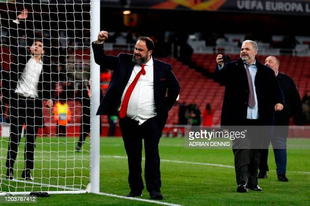 Olympiakos' president Evangelos Marinakis celebrates on the pitch after the UEFA Europa league round of 32 second leg football match between Arsenal...