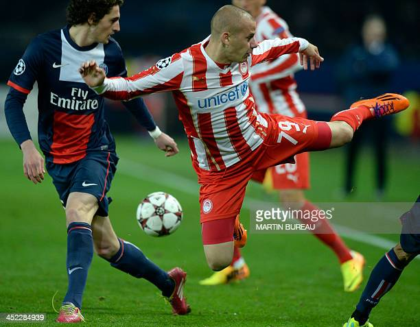 Olympiakos' Slovakain midfielder Vladimir Weiss misses the ball during an UEFA Champions League group C football match between Paris SaintGermain and...