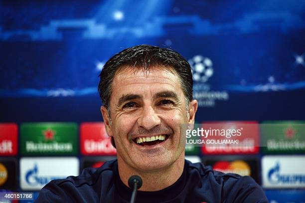 Olympiakos' Spanish coach Michel smiles during a press conference on the eve on the group A Champions League football match Olympiakos vs Malmo at...
