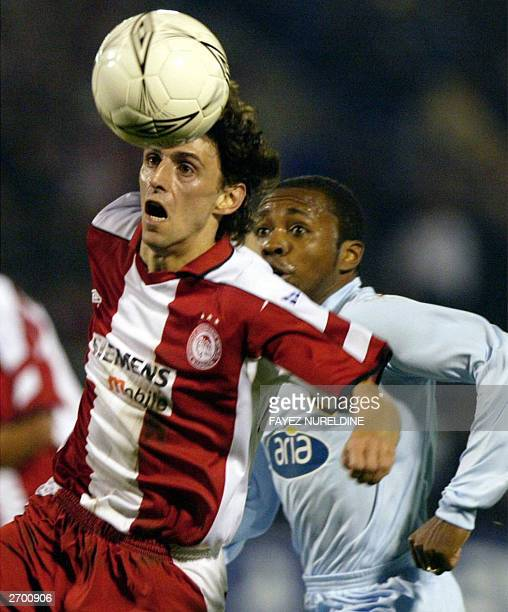 Olympiakos' Stylianos Venetidis gets to the ball ahead of Galatasaray's Luis Prates during their European Champions League group D soccer match in...