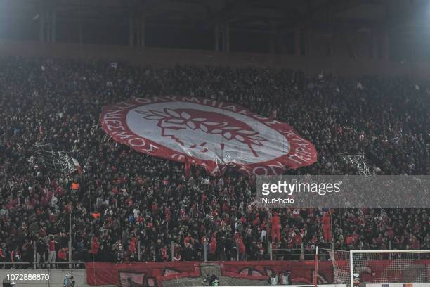 Olympiakos supporters display a banner