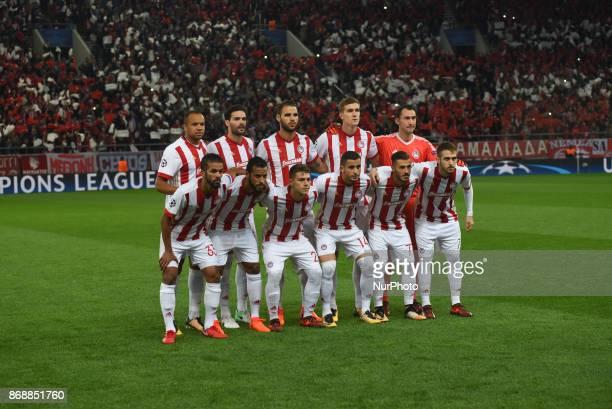 Olympiakos team players Olympiacos' Moroccan midfielder Mehdi CarcelaGonzalez Olympiacos' FrenchTogolese midfielder Alaixys Romao Olympiacos' forward...