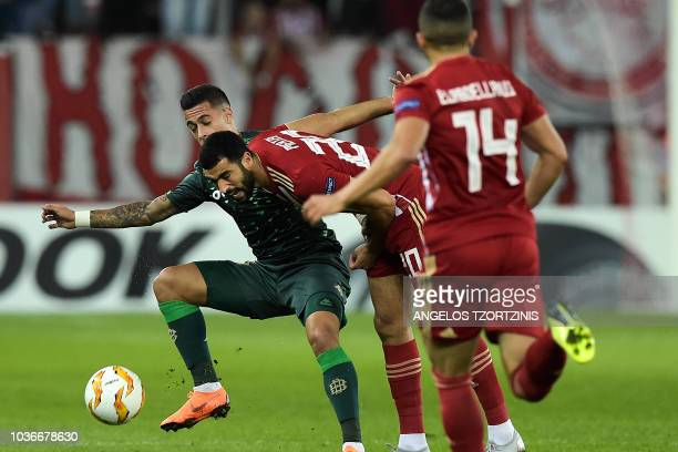 Olympiakos' Yassine Meriah fights for the ball with Real Betis' Cristian Tello during the UEFA Europa League Group F football match between...