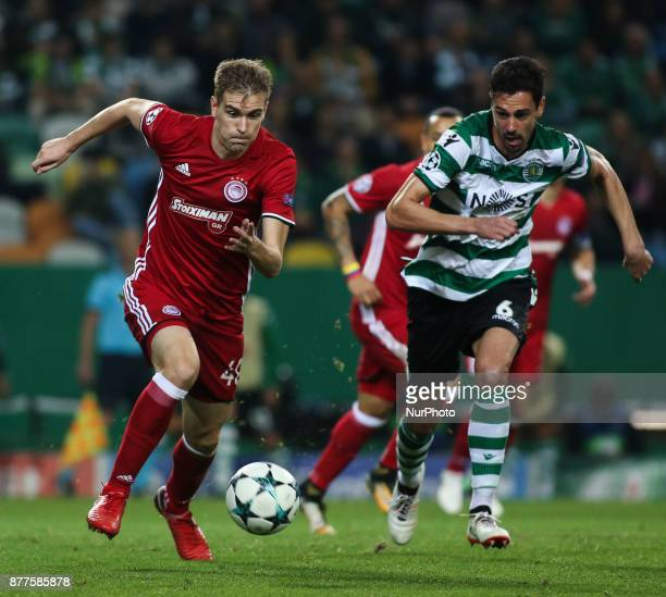 Olympiakos's defender Bjorn Engels vies with Sporting's defender Andre Pinto during the Champions League football match between Sporting CP and...