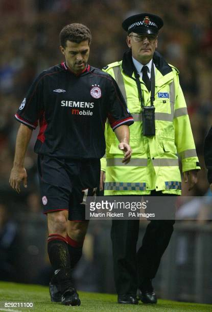 Olympiakos's Ze Elias is escorted from the pitch after being sent off against Manchester United during the first round Group F UEFA Champions League...