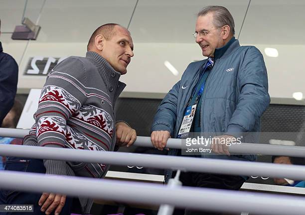 Olympian Alexander Karelin of Russia and Jacques Rogge former IOC President attend the Men's Ice Hockey Semifinal Playoff between Sweden and Finland...