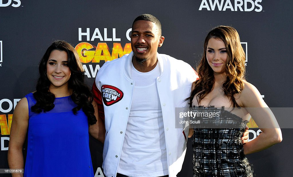 Olympian Aly Raisman, Nick Cannon and Olympian McKayla Maroney (L-R) attend the Third Annual Hall of Game Awards hosted by Cartoon Network at Barker Hangar on February 9, 2013 in Santa Monica, California. 23270_002_JS_0925.JPG